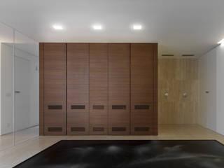 Residenza Privata Pareti & Pavimenti in stile minimalista di Reggiani SPA Illuminazione Minimalista