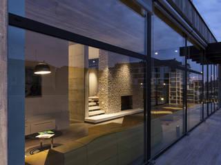 Residenza Privata Soggiorno moderno di Reggiani SPA Illuminazione Moderno