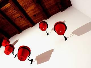 Moriglione Sala da pranzo moderna di deltastudio Moderno