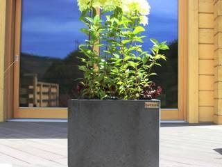 Donice betonowe: styl , w kategorii Ogród zaprojektowany przez Bettoni
