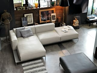Industrial design - Doimo sofas -Metropolis:  in stile industriale di IMAGO DESIGN, Industrial