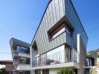 HANMEI - LEECHUNGKEE Casas de estilo moderno