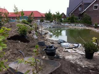 Jardines de estilo clásico de Fischer Garten-und Landschaftsbau GmbH Clásico