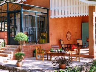 Célia Orlandi por Ato em Arte Casas de estilo rural Piedra Naranja