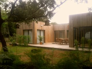 Oasis: Maison de style  par cabanesdesign