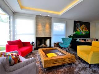 ELITE HOUSE: Salas de estar modernas por ARQ Ana Lore Burliga Miranda