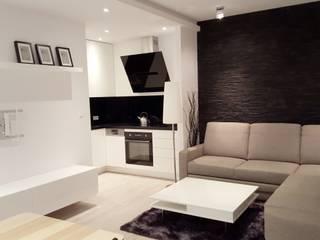 Czarno białe mieszkanie dla singla : styl , w kategorii Salon zaprojektowany przez Project Art Joanna Grudzińska-Lipowska