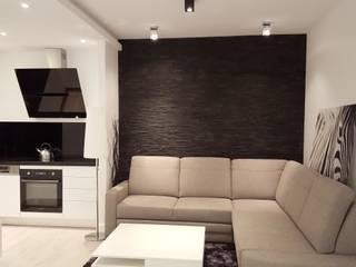 Czarno białe mieszkanie dla singla : styl , w kategorii  zaprojektowany przez Project Art Joanna Grudzińska-Lipowska