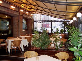 veranda per RISTORANTE: Hotel in stile  di Cagis