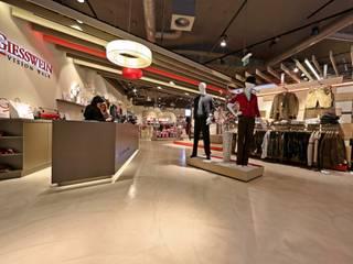 Bodengestaltung Schauraum Moderne Ladenflächen von IBOD Wand & Boden Modern