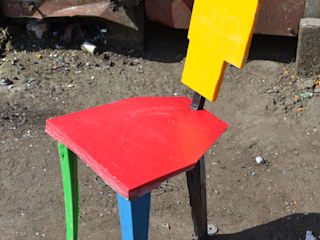 The Red Blue Green Yellow and Black Chair: industrial  by Rag and Bone Workshop, Industrial