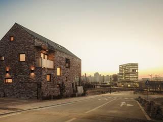 Casas de estilo moderno de (주)유타건축사사무소 Moderno