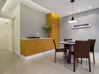 São Caetano 63: Salas de jantar  por Casa 27 Arquitetura e Interiores