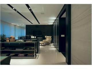 APTO BELVEDERE: Salas de estar modernas por Cassio Gontijo Arquitetura e Decoração