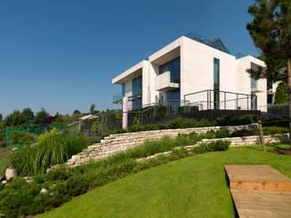 Jardines de estilo moderno de WIZJA Moderno