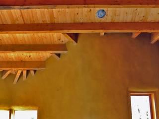 Paredes y pisos de estilo rural de Ecohacer Bioarquitectura y Bioconstrucción Rural