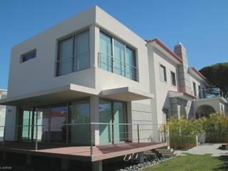 Remodelaçãoe ampiação de moradia Casas modernas por Castello-Branco Arquitectos, Lda Moderno