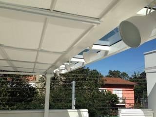 Residência Guatás Varandas, alpendres e terraços modernos por Vitor Dias Arquitetura Moderno