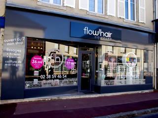 Agencement de façade: Locaux commerciaux & Magasins de style  par Martinez Design