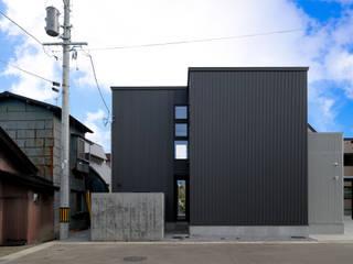 フクシアンドフクシ建築事務所 Casas de estilo ecléctico