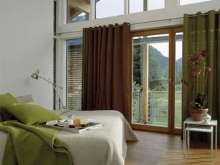 Спальня в стиле модерн от Bau-Fritz GmbH & Co. KG Модерн