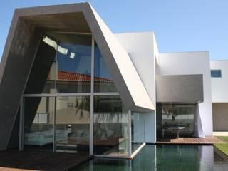 Casa Birre 3: Casas  por Areacor, Projectos e Interiores Lda