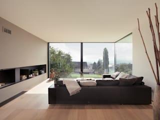 Salas de estilo moderno por meier architekten