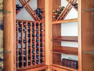 Wine cellar by Juliana Stefanelli Arquitetura e Design,