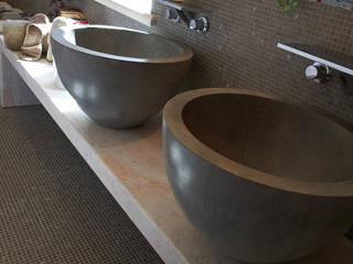 Baños de estilo  de Arte Pietra