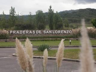 Praderas de San Lorenzo: Pasillos y recibidores de estilo  por Proyecto Norte