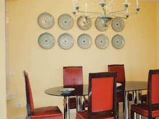 progetti: Sala da pranzo in stile  di L' Archivolto - Progettazioni di  Architetture e d'Interni