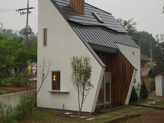 Casas estilo moderno: ideas, arquitectura e imágenes de 건축사사무소 스무숲 Moderno