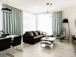 mieszkanie prywatne 3 pokoje czarno-białe - apartamenty na polanie - Gdynia : styl , w kategorii Salon zaprojektowany przez Anna Maria Sokołowska Architektura Wnętrz ,Nowoczesny