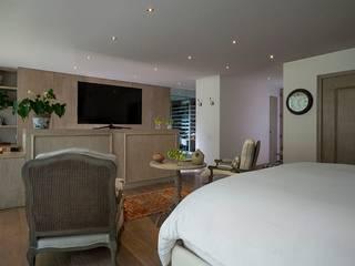 Dormitorios de estilo  de JR Arquitectos
