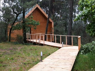 Rustic style house by NORMA | Nova Arquitectura em Madeira (New Architecture in Wood) Rustic Solid Wood Multicolored