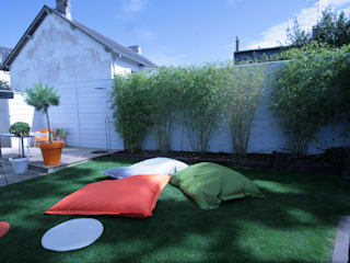 Les coussins géants du jardin de la maison roulante: Jardin de style de style eclectique par Tabary Le Lay