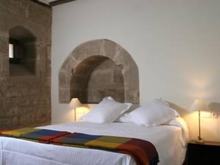 Hotel at a Baroque XVIII Century House Ignacio Quemada Arquitectos Classic style bedroom Stone White