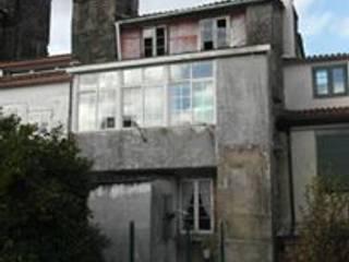 Estado original de la fachada trasera totalmente desvirtuada: Casas de estilo  de DICOMPOSAR-EUGENIO TORREIRA ARQUITECTO