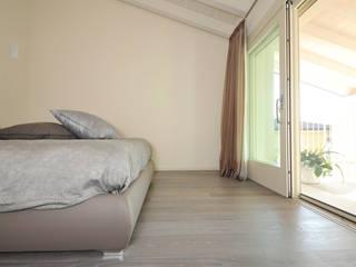EMMEDUE di Ferruccio Mattiello Modern style bedroom Wood