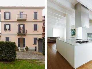 sopralzo di villa storica a milano : Soggiorno in stile  di recuperosottotetti