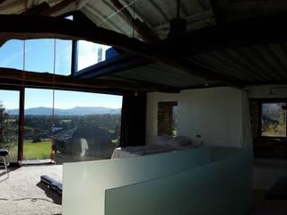 Dormitorios de estilo moderno de Tagarro-De Miguel Arquitectos Moderno