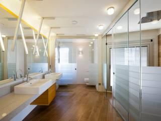 Can Roig Baños de estilo moderno de Rios-Casariego Arquitectos Moderno