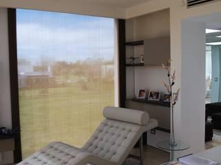 vivienda unifamiliar Salas multimedia modernas de cm espacio & arquitectura srl Moderno