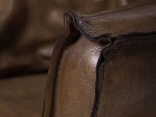 Zeitloser Vintage Sessel aus Büffelleder. Woodzs KücheTische und Sitzmöbel Leder