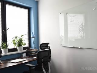 Gabinet w wersji dla niego: styl , w kategorii Domowe biuro i gabinet zaprojektowany przez Milan design