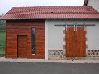 Transformation d'une ancienne gare en logements locatifs Kauri Architecture Maisons modernes