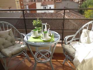 Rios Rosas: Terrazas de estilo  de Tu Casa Home Staging