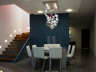 Modern dining room by INDICO Modern