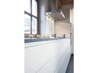 Planung und Umsetzung eines Koch- und Essbereiches in Wagrain:  Küche von FRAME Innenarchitektur