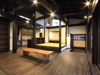 薪ストーブの家  群馬県 中之条町: 田村建築設計工房が手掛けたリビングです。